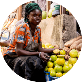 African woman at a fruit stand