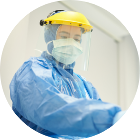 Profile of a medical professional with protective gears