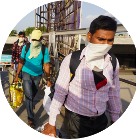 Group of workers with face covers in India