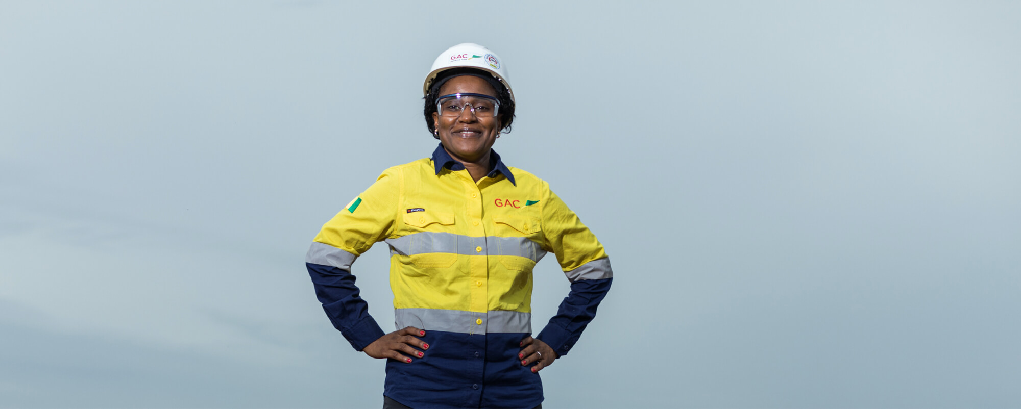 Profile Aissata Beavogui with a hardhat and her company uniform