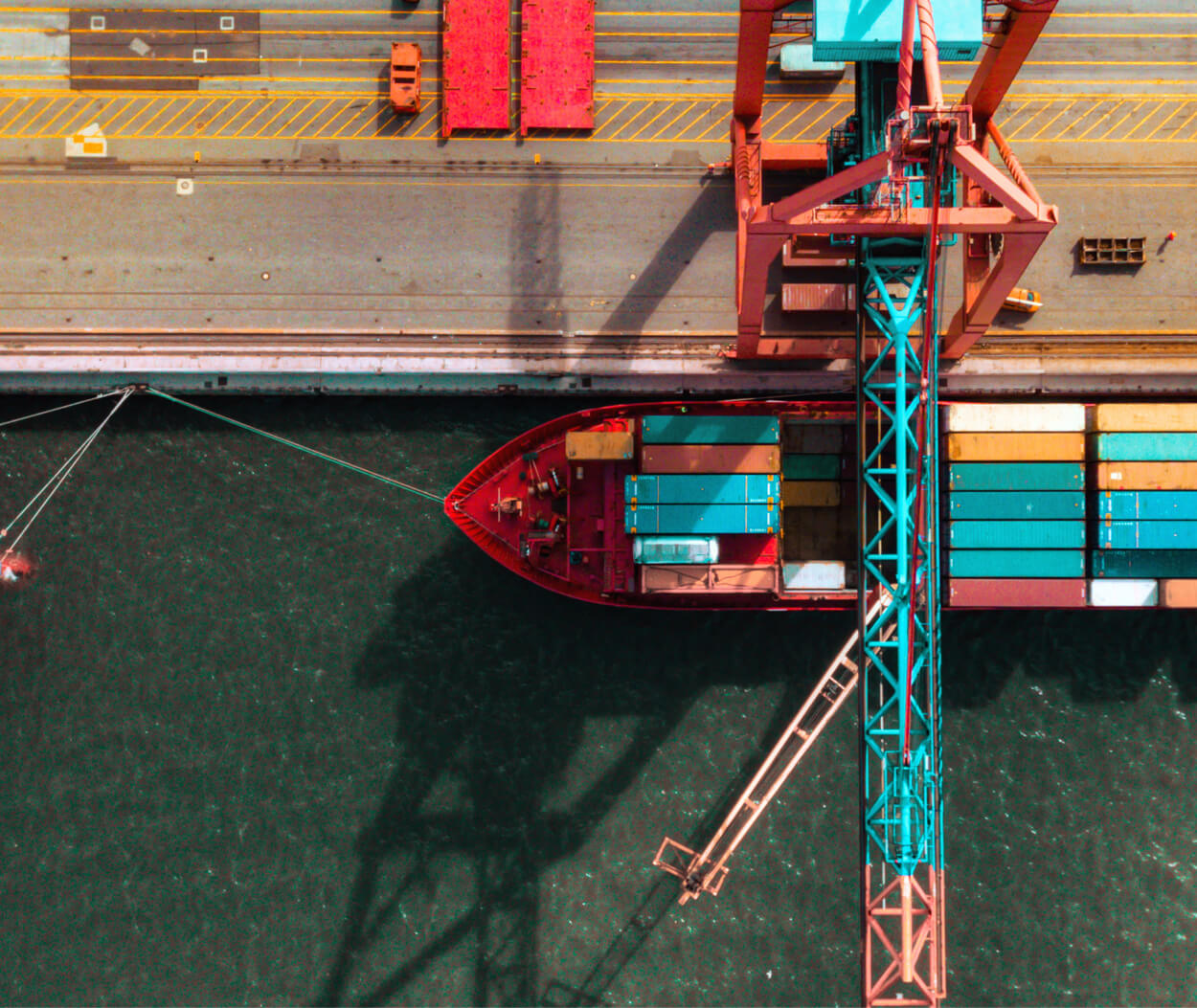Aerial view of a container crane and a cargo ship