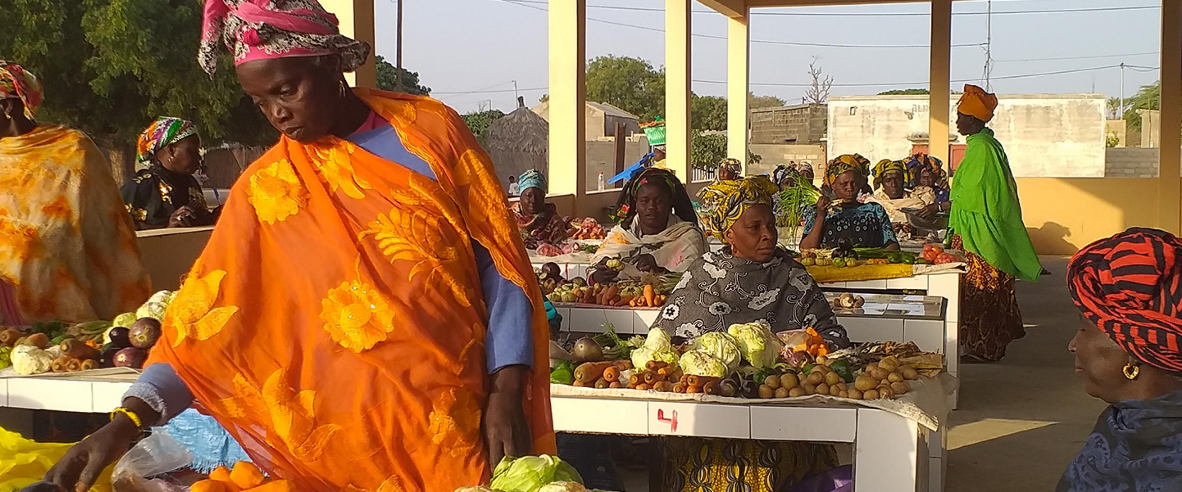 A woman in the Taiba N'diaye Commune sells her fresh produce at a new marketplace provided by the Lekela project.