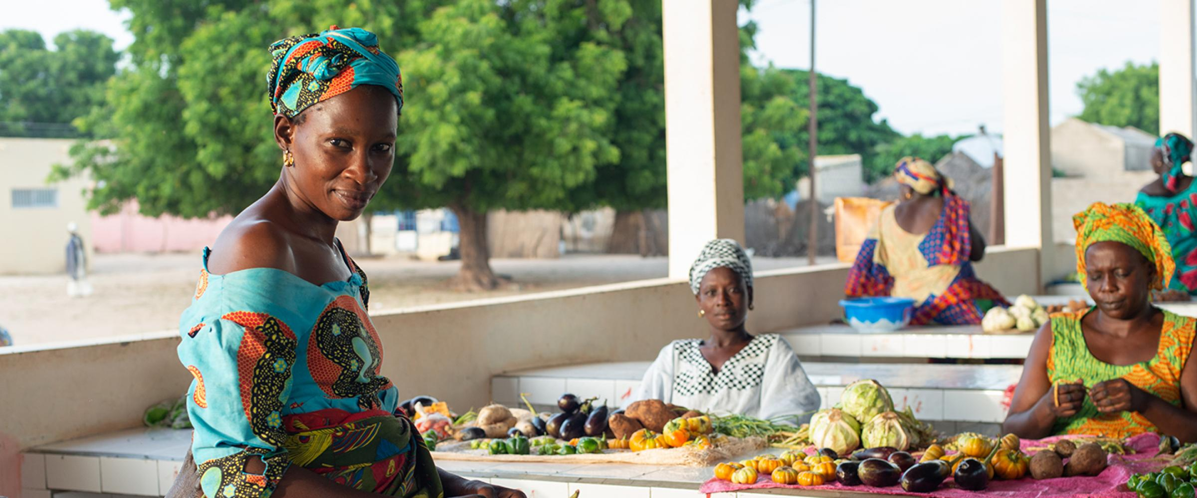 The Lekela project is helping to empower women in Taiba N'diaye, Senegal.  (From left to right) Mme. Wade, Mme. Ndiaye, and Mme. Mame Seye Gueye are proud to sell their vegetables at the market stalls.