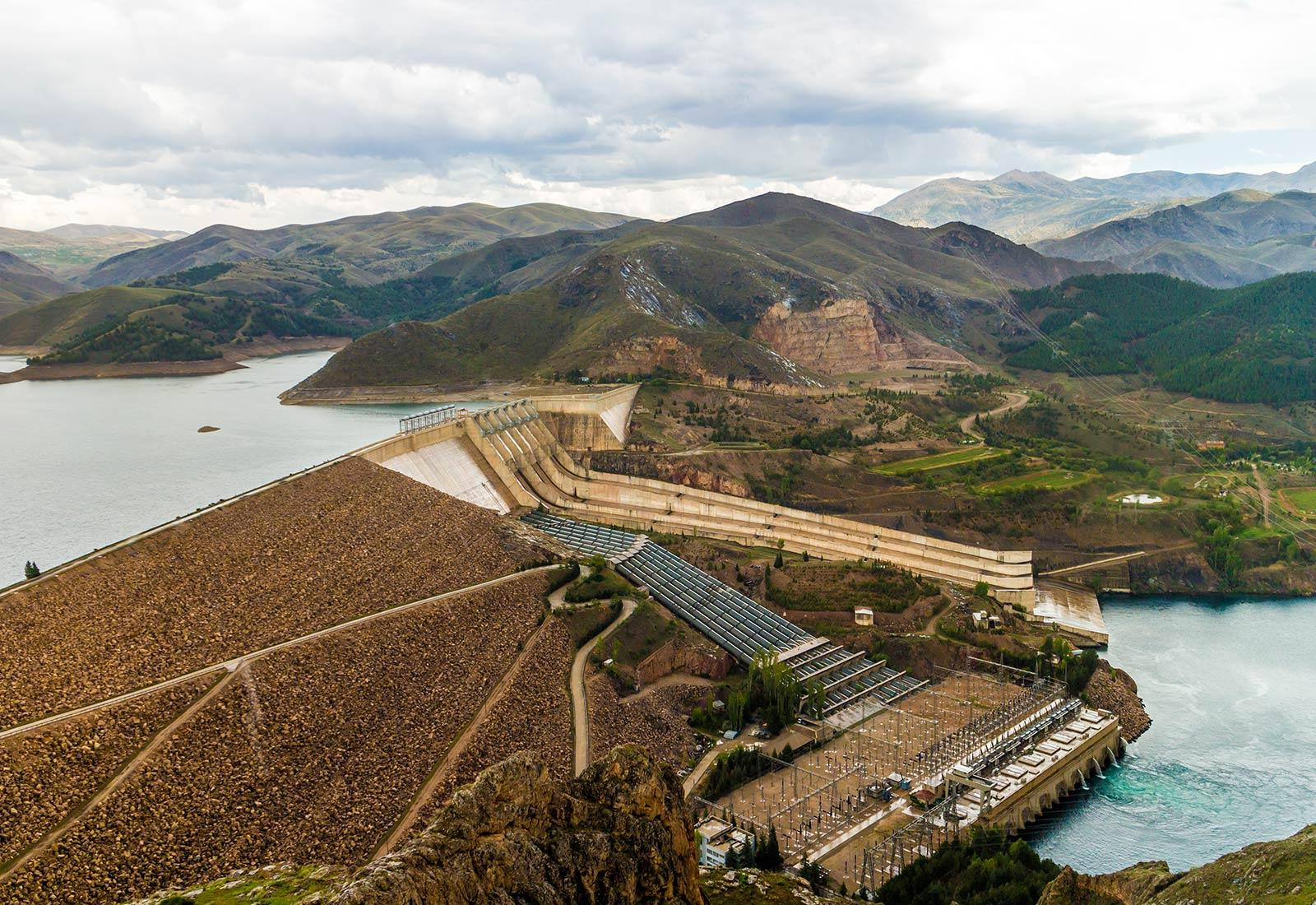 hydropower dam with mountains